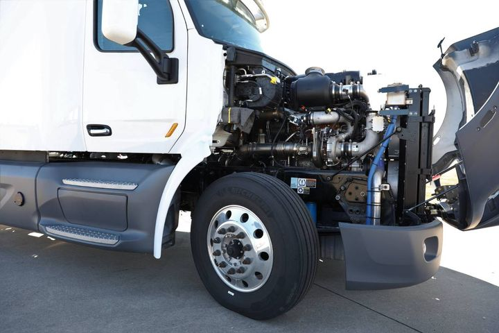 A photo of a three-cylinder 10.6L heavy-duty diesel engine, part of a project funded by the California Air Resource Board, in a Peterbilt 579 truck. The newly announced project builds upon this project by developing designs that will enable 2- and 4- cylinder variants to expand the power and torque range with a common power cylinder system.  - Photo: Achates Power