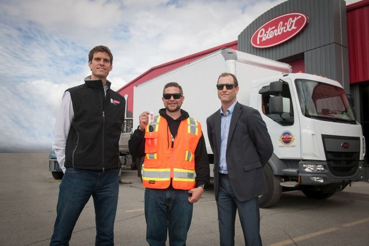Handing off the keys (L-R)are Chris Devine, CEO, Peterbilt of Alaska; Mark Spafford, General Manager SWS;and Darryl Oster, Chief Engineer for Global Zero Emissions, PACCAR. - Photo: Peterbilt