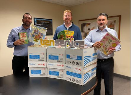Preparing the Transervice Book donations for pick up by The Book Fairies are (l-r) Sean Schipper, marketing and social media manager; Gregg Nierenberg, CEO and president; and Alex Lafaras, CFO and EVP. - Photo: Transervice