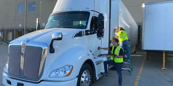 Velociti technicians install new 4G trailer tracking and in vehicle devices.