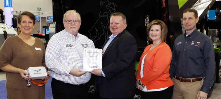 The Godwin Group received the Work Truck Show 2019 Innovation Award in the Safety category for its Road Runner remote dump system. Accepting the award on behalf of Godwin from NTEA President & CEO Steve Carey (center) are (l-r) Phyllis Godwin Norris, Corp. Vice President and VP of Sales; Pat Godwin (Jr.), Corp. President, R&D/Gov. Contract; Kristie Stockman, National Sales Manager; and Patrick Godwin III, CMO.