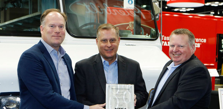 Morgan Olson received the Work Truck Show 2019 Innovation Award in the Body/Upfit category for its Spring-Back front bumper. Accepting the award from NTEA President & CEO Steve Carey (at right) are (left) Rich Tremmel, Vice President of Sales & Marketing, and (center) Dan DesRochers, Chief Operating Officer
