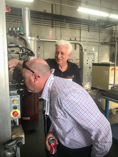 Eric Winterset, Superintendent of Maintenance at the City of Long Beach, Calif., watches first-hand what the Atomic-Forged process looks like.  - Photo courtesy of PureForge