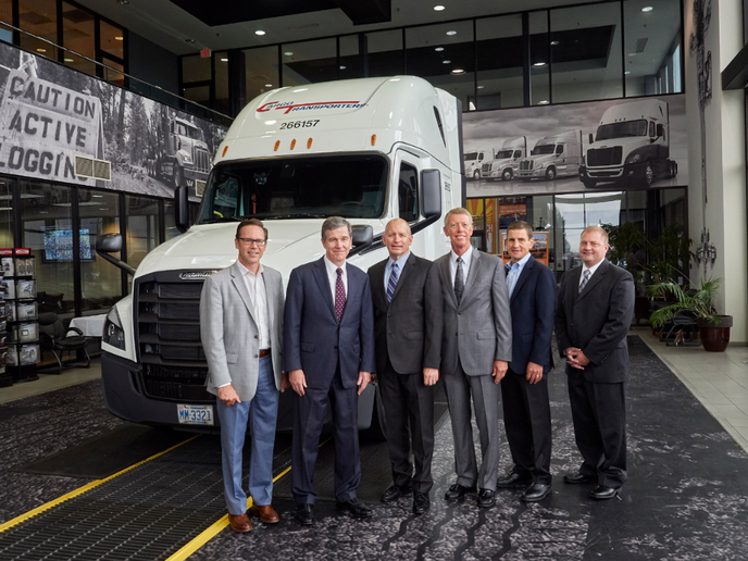 (l-r) DTNA Senior Vice President of Operations and Specialty Vehicles Jeff Allen, North Carolina Governor Roy Cooper, DTNA CEO Roger Nielsen, Freightliner Trucks Vice President of Sales Bob Correll, Cleveland Truck Manufacturing Plant Manager Erik Johnson, and Chairman of Cargo Transporters John Pope met at DTNA's truck manufacturing plant in Cleveland, N.C.  - Photo courtesy of Frieghtliner