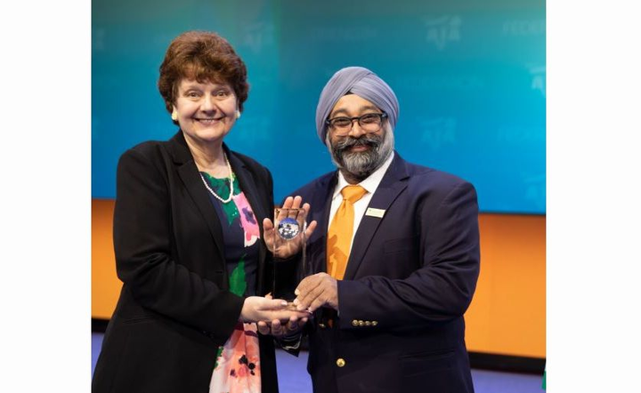 Penske Logistics is a recipient of the 2018 Freight Carrier Excellence Award from the United States Environmental Protection Agency's (EPA) SmartWay program. SmartWay Director Cheryl Bynum (left) is posing with Penske's Senior Manager of Fuel Services Virind Gujral.