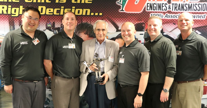 JASPER Partnership Award recipient Bill Levy (center) from U.S. Tool and Manufacturing Company shows off his trophy with members of the Jasper team. 