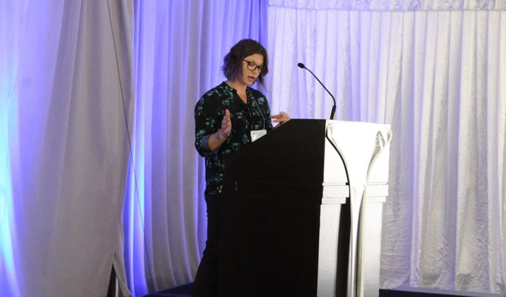 Work Truck's Executive Editor, Lauren Fletcher, addressed conference attendees on the future of the medium-duty diesel engine market.  - Photo: Joe Polich