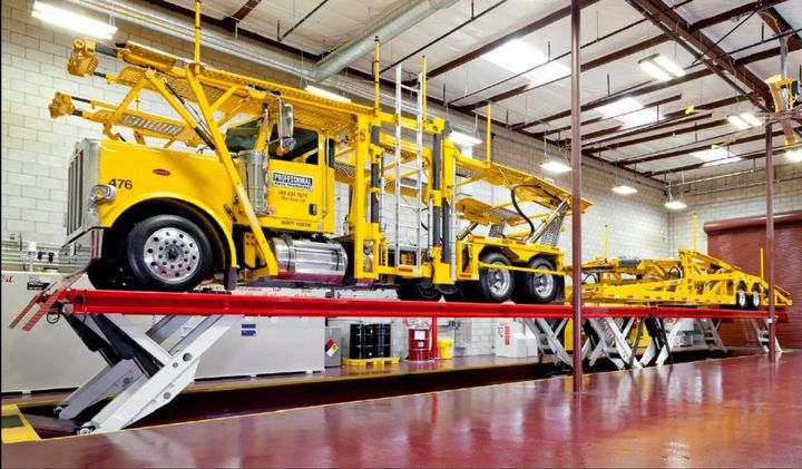 A Transporter Truck sits on a Stertil-Koni SKYLIFT ready to be inspected and worked on. 