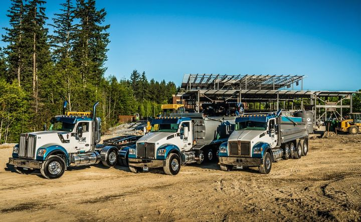 PGH Excavating operates 15 heavy-duty vocational trucks, primarily a mix of Kenworth long hoods and vocational models. - Photo: Kenworth