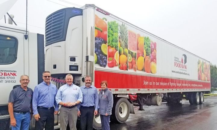 Serving Central Pennsylvania – Carrier Transicold recently gave the Central Pennsylvania Food Bank an X4 Series trailer refrigeration unit through its program to help food banks in the Feeding America network. Shown are Ray Swank, transportation manager for the food bank; Tim Shustack territory manager for the dealership that installed the unit, Carrier Transicold of Pennsylvania; Joe Arthur, executive director of the food bank; Wayne Souder, dealer branch manager; and Beth Hamilton, director of food sourcing and logistics for the food bank. - Photo: Carrier Transicold