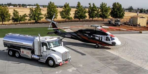 To keep its helicopter operation running, PJ Helicopters owns a fleet of Kenworth T880 trucks...