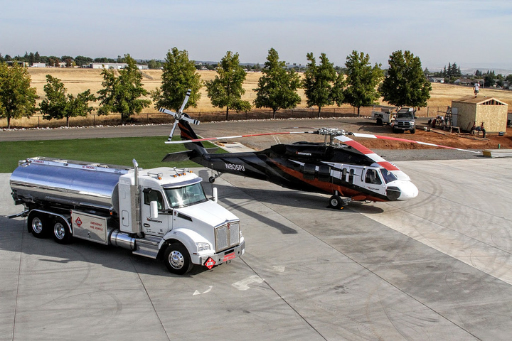 To keep its helicopter operation running, PJ Helicopters owns a fleet of Kenworth T880 trucks fitted with fuel tanks.  - Photo courtesy of TruckPR