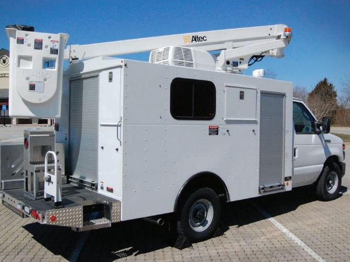 For the AT200A recall, Altec will notify owners, and dealers will install a guard kit over the pole guide controls, free of charge. - Photo: Altec