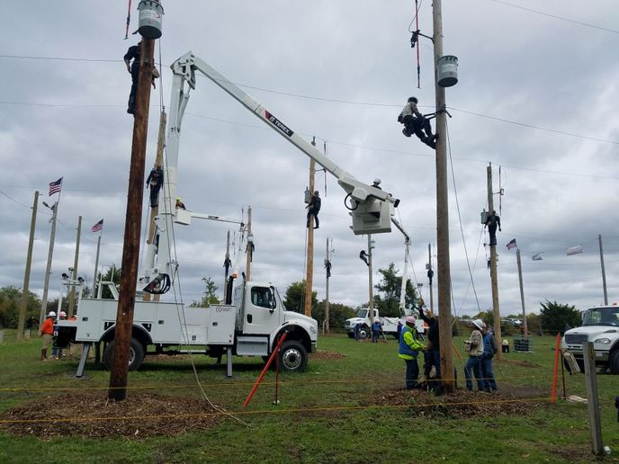 Terex Optima TC55 aerial devices were used to set up the Hurtman Rescue event, where line workers are tasked to safely lower an unsoncious worked at the top of an electrical pole.