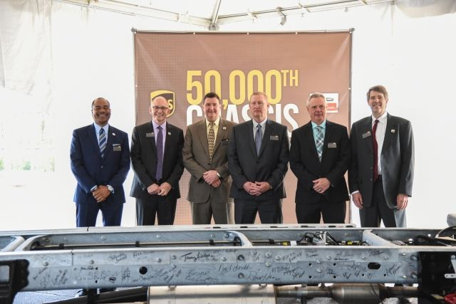 (L-R) Carlton Rose of UPS, Roger Nielsen of DTNA; Rick Jordan of UPS, Billy Benson of UPS, Mike Casteel of UPS, and Jeff Sather of FCCC stand behind the autographed 50,000th UPS chassis, an MT-45 model. Photo courtesy of FCCC