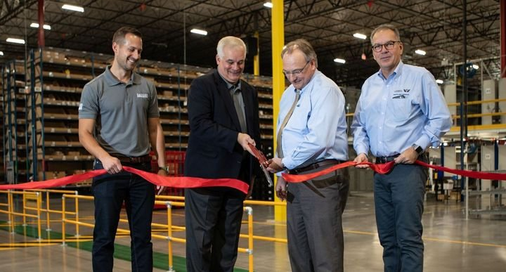 Stefan Kurschner (r), SVP of Aftermarket for DTNA, and others inaugurate the all-new Goodyear, Ariz. Parts & Distribution Center.  - Photo: DTNA
