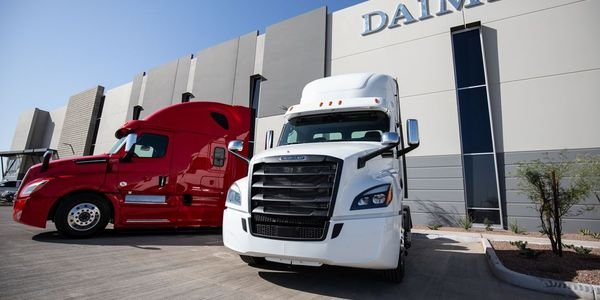 Two Freightliner Cascadias stand guard outside the all-new Goodyear, Ariz. Parts & Distribution...