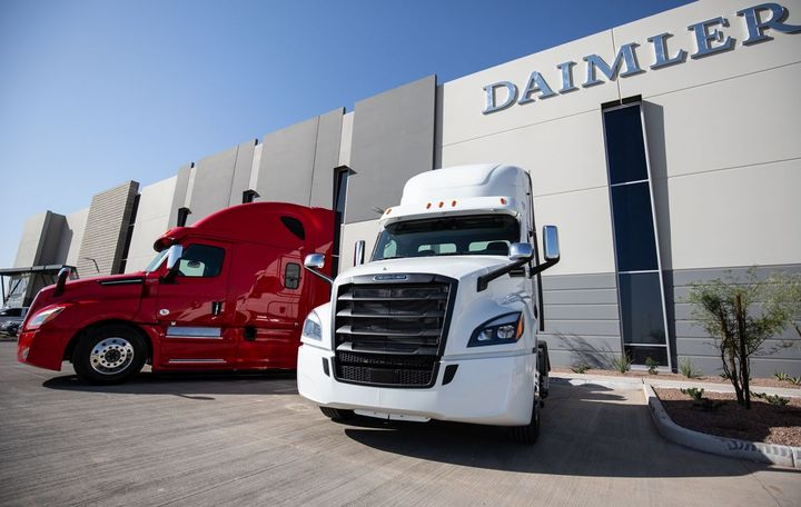 Two Freightliner Cascadias stand guard outside the all-new Goodyear, Ariz. Parts & Distribution Center.  - Photo: DTNA