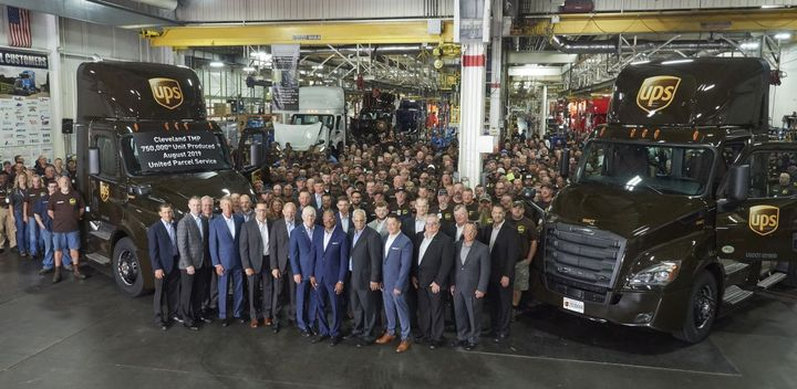 Representatives of DTNA, UPS and Peach State Truck Centers celebrate the 750,000th truck from Cleveland Truck Manufacturing Plant.