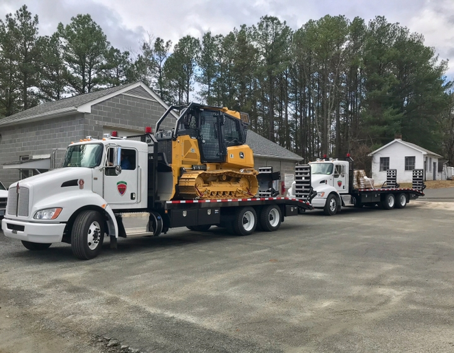 Each dozer is mated to a truck, which has a beaver-tail loading ramp. Spread out among three regions in Virginia, drivers of the Kenworth T370s also operate the bulldozers. Photo courtesy of Kenworth