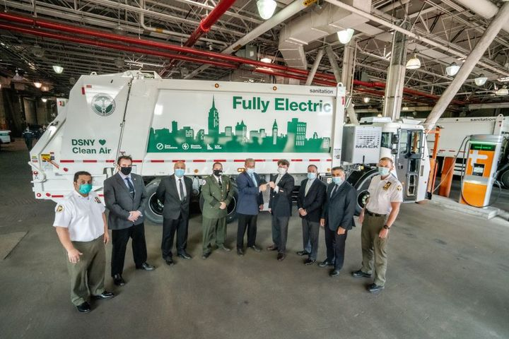 Pictured left to right are DSNY Superintendent Anthony Donofrio; DSNY Deputy Director Michael Matkovic; DSNY Deputy Director Spiro Kattan; DSNY Assist. Chief Joseph Cendagorta; DSNY Deputy Commissioner Rocco DiRico; Mack Trucks National Account Manager John Stuart; Vasso Waste Systems President Tony Vasso; DSNY Deputy Director Giovanni Ianniello; DSNY Superintendent James Anderson. - Photo: Mack Trucks
