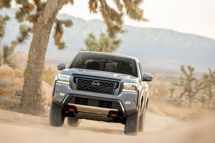 The all-new rugged exterior design features a powerful front end with a massive grille and chiseled hood, framed by new precision interlocking headlights. - Photo: Nissan