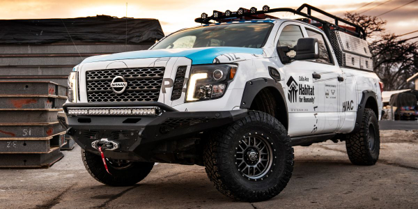 Originating as a stock Titan XD Diesel Crew Cab Midnight Edition, transformation into the...