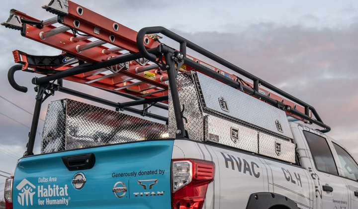 Atop the Ultimate Work Titan sits a TrailFX aluminum ladder rack featuring multiple commercial grade ladders