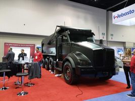 This blacked out beauty was a Kenworth T880 truck upfit by Palmer Power & Truck Equipment.