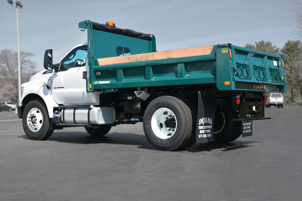 This Ford F-650, dual rear-wheel, 158-inch wheelbase is upfitted with a Rugby 11foot, ¾ Yard...