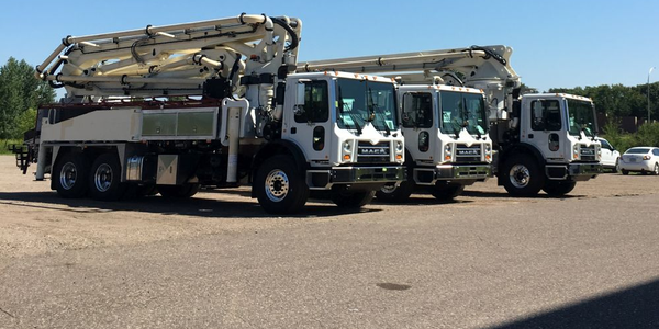 Concrete pump trucks are used in construction for transporting mixed concrete.