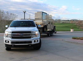 Capable of towing 11,400 pounds or hauling 2020 pounds of payload, the first diesel Ford F-150 truck arrived hauling a pretty famous Humvee. Photo by Lauren Fletcher