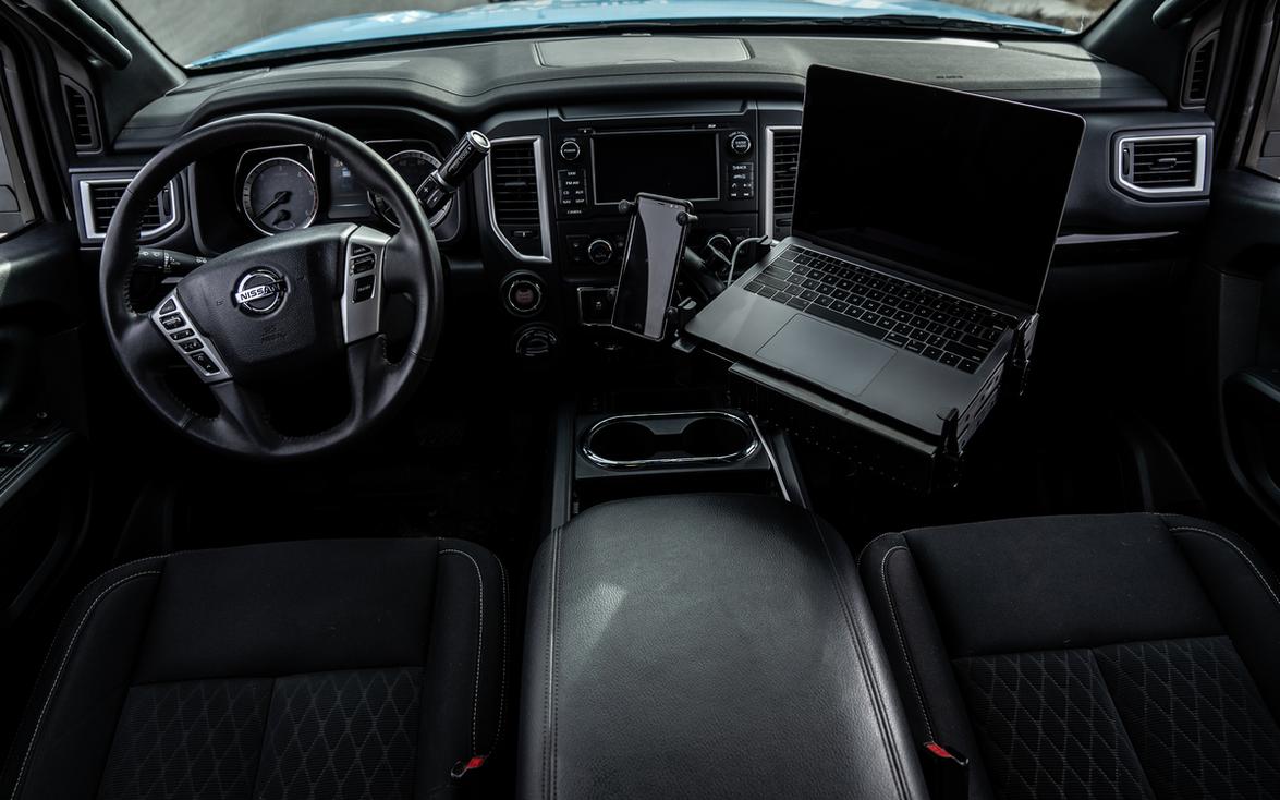 Inside the truck is a mobile office, equipped with a mounted 13-inch laptop, printer, and a...
