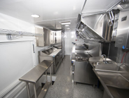 The commercial kitchen is designed to hold as many as 10 food preparation professionals when...