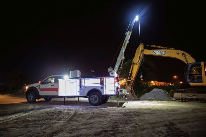 The new boom tip lights are capable of covering 2,700 sq. ft. at a 30-foot radius. - Photo:Palfinger