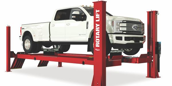 The lift can accommodate a wide range of vehicles, from passenger vehicles to larger work trucks.