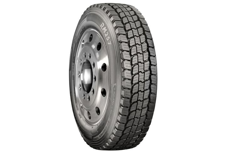 The Roadmaster RM257 tire is an open-shoulder tire with three tread blocks in the center. -