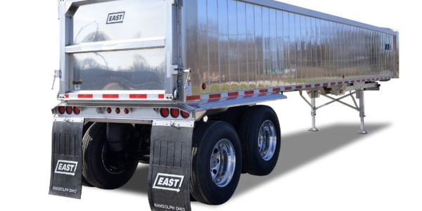 The narrow spec dump trailer provides up to 1/2-ton additional payload compared to a standard...