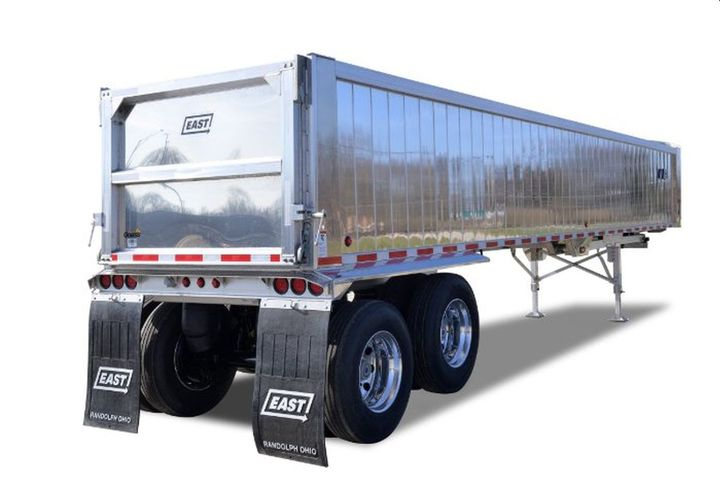 The narrow spec dump trailer provides up to 1/2-ton additional payload compared to a standard aluminum dump trailer. - Photo: East Manufacturing Corp.