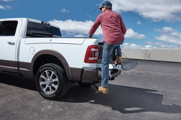 With one quick push of the foot, the available Mopar bed step deploys from underneath the rear bumper to offer a firm foothold. - Photo: Mopar