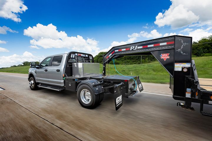 The bed is rated for 30,000 pounds in both the gooseneck and 5th-wheel configurations, thanks to an exclusive partnership with CURT trailer hitches. - Photo: CM Truck Beds