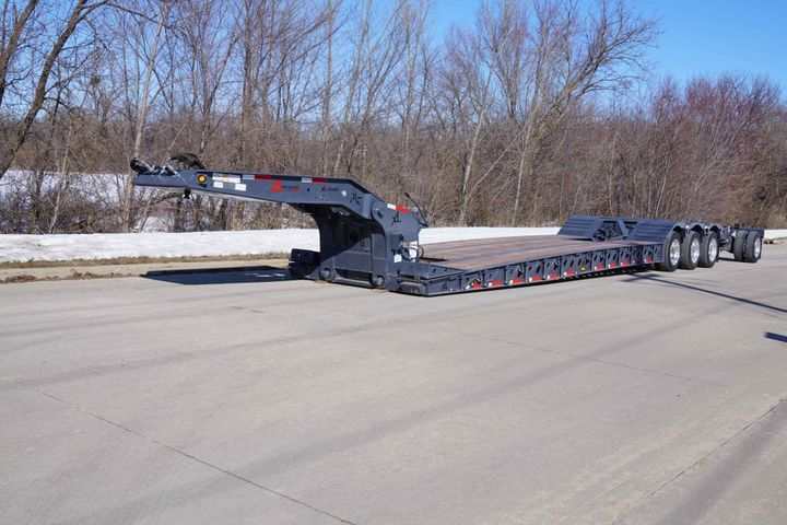The XL Low-Profile HDG has tapered front beams and 42-inch flip ramps provide extra loading assistance, making it an ideal solution for the paving industry. - Photo: XL Specialized Trailers