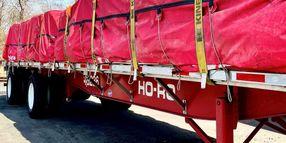 Reflective VeeBoards Illuminate Trailer Cargo
