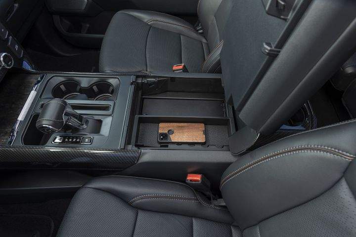 Finished with a durable black texture powder coat, the console safe provides years of dependable use with full access to the factory accessory tray, armrest, and lid. - Photo: Tuffy Security Products