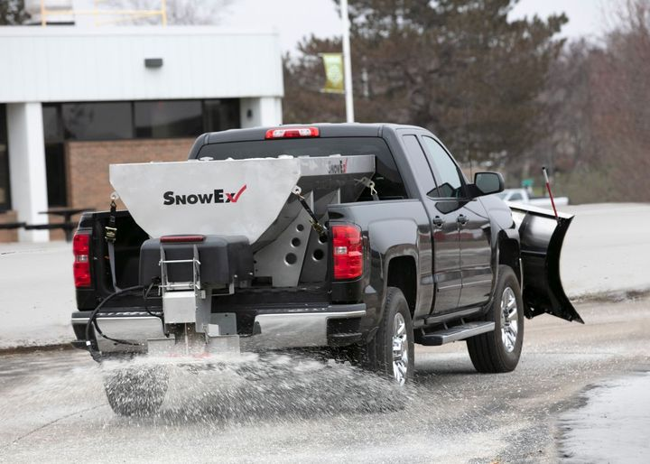 With the addition of a pre-wet and direct liquid application kit, which includes pre-wet tanks, a pump and a spray kit, the spreaders have the ability to pre-wet materials or spray brine directly onto the driving surface for anti-icing applications - Photo: SnowEx