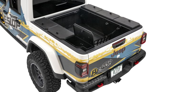 Multiple BullRing tie downs are affixed to the side of the lockboxes so the included nylon net can be used to secure larger gear in the pickup bed. - Photo: Tuffy Security Products