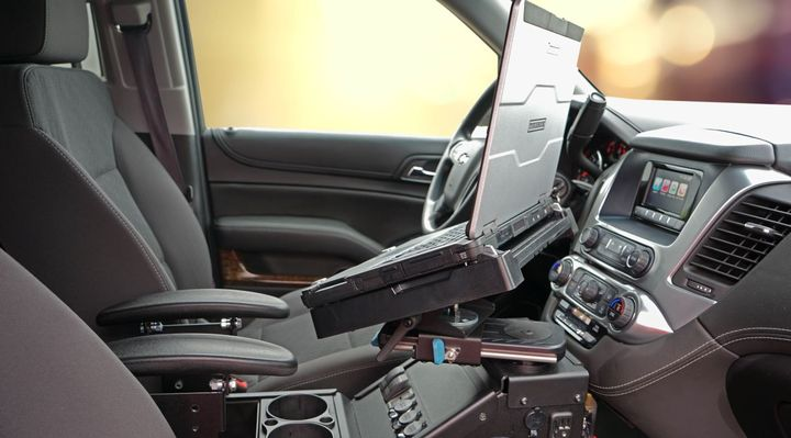 This Panasonic Toughbook fits into the Gamber Johnson mount installed inside a Chevrolet Tahoe SUV. 