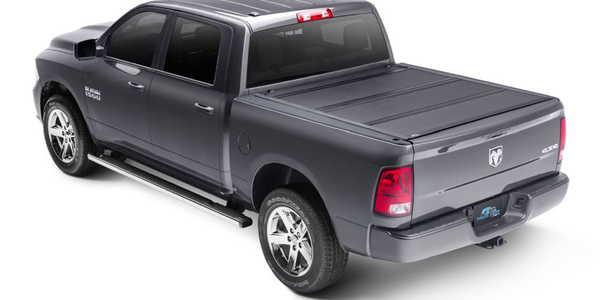 The LXP Tonneau Cover features a low-profile design with flush-mounted panels.