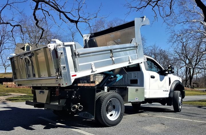 The EBY Fullback dump body is a general purpose aluminum truck body that can be customized to fit different applications.