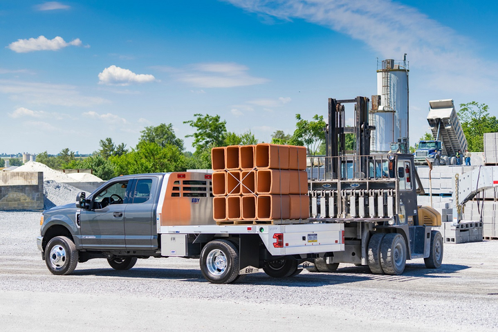 The Big Country, all-aluminum truck body from EBY is a flatbed towing body available in a variety of sizes for Ford, GM and Ram chassis.  - Photo via EBY